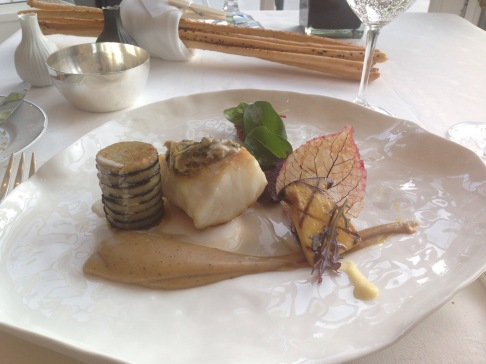Poached and roasted French turbot, Celeriac and black truffle, Braised potatoes purée, oysters sauce